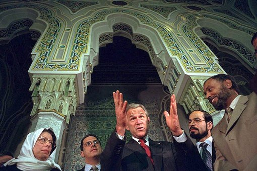 """Nihad Awad (second from right) stands to President Bush's left, when Bush said """"Like the good folks standing with me, the American people were appalled and outraged at last Tuesday's attacks [on Sept. 11, 2001]."""