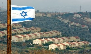 Israeli flag flutters over view of Jewish settlement of Ofra