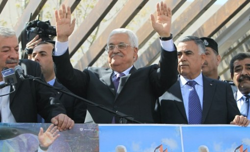 Palestinian Authority President Mahmoud Abbas waves to his supporters following his trip to Washington, DC, on Thursday, March 20, 2014, in the West Bank city of Ramallah (AFP/Abbas Nomani)