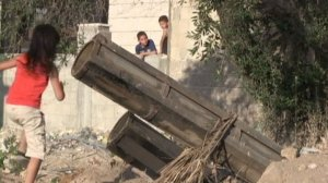 © FRANCE 24 | A screen grab from a FRANCE 24 video shows children playing near a Hamas rocket launcher in Gaza.