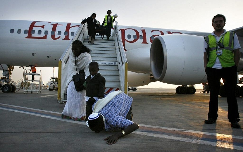 Ethiopian Jews kissing the ground in Israel