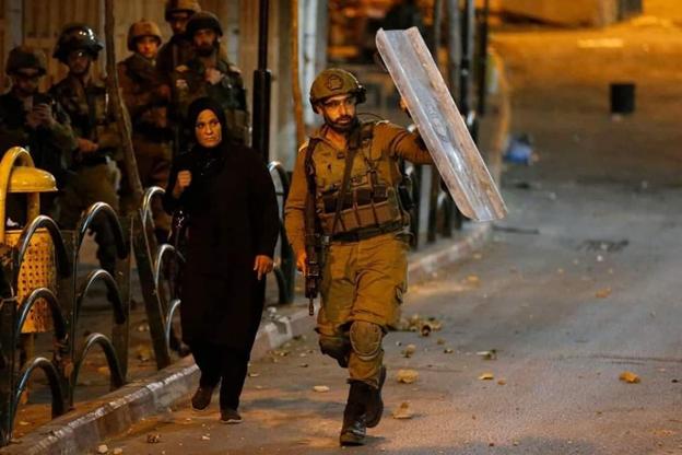 Idf shields Muslim woman